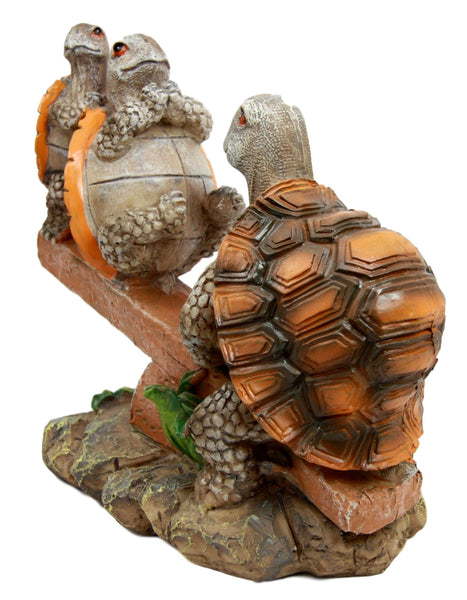 Mother Turtle Playing with Her Babies On Seesaw Figurine