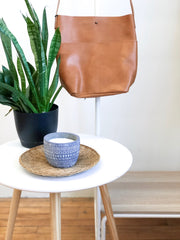 candle and handbag hanging with plant