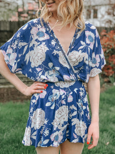 blue romper with floral print ladder trim flowy sleeves
