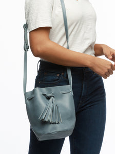 maria drawstring tassel leather bucket bag denim blue
