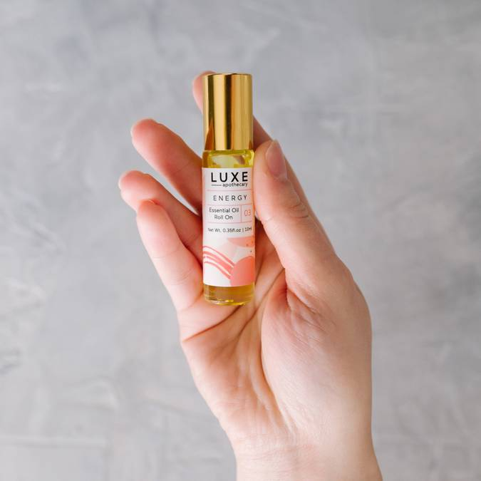 luxe apothecary essential oil roll on blend energy in hand