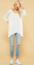 loose fit 3/4 top with asymmetrical hem