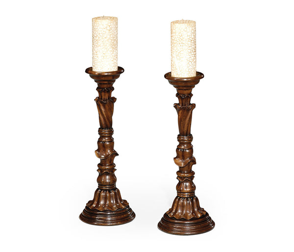 Pair of Rococo style walnut candlesticks
