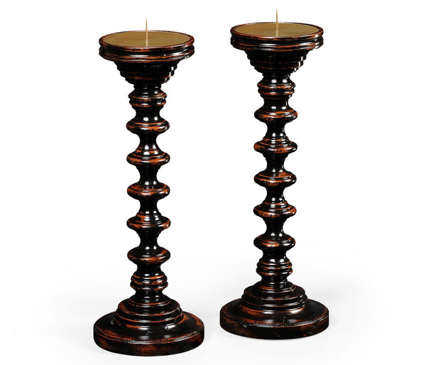 Pair of turned black painted candlesticks