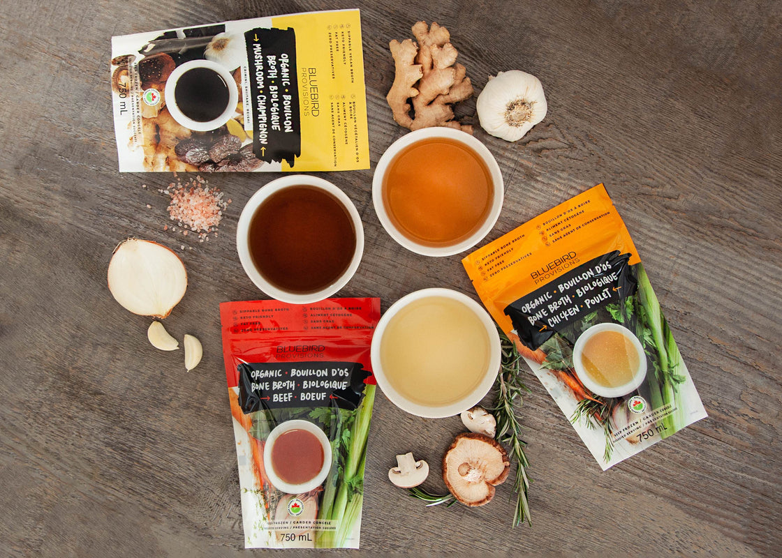 organic bone broth packaging with onions, ginger, garlic, medicinal mushrooms, thyme, parsley and superfoods