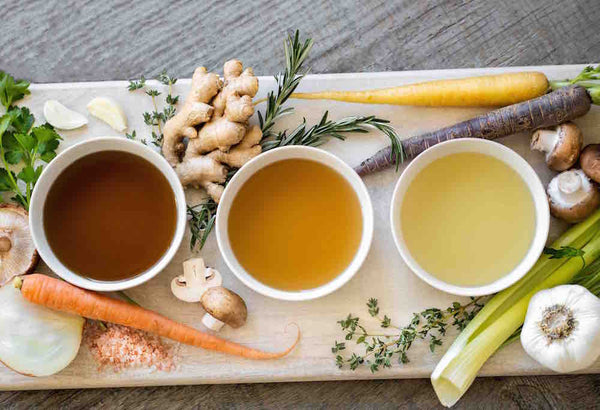 group shot of beef bone broth, chicken broth and vegetable stock.