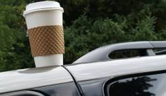 Coffee cup on top of car
