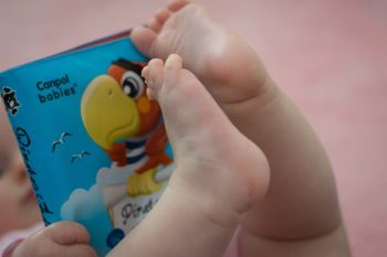 Baby book and baby feet