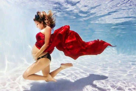 Underwater maternity photo red dress