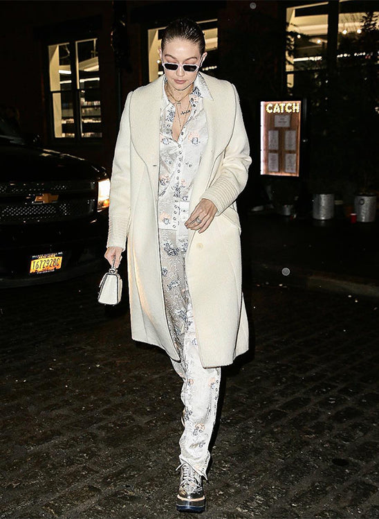 Gigi Hadid in the Long Coat with Fur Collar in Ivory