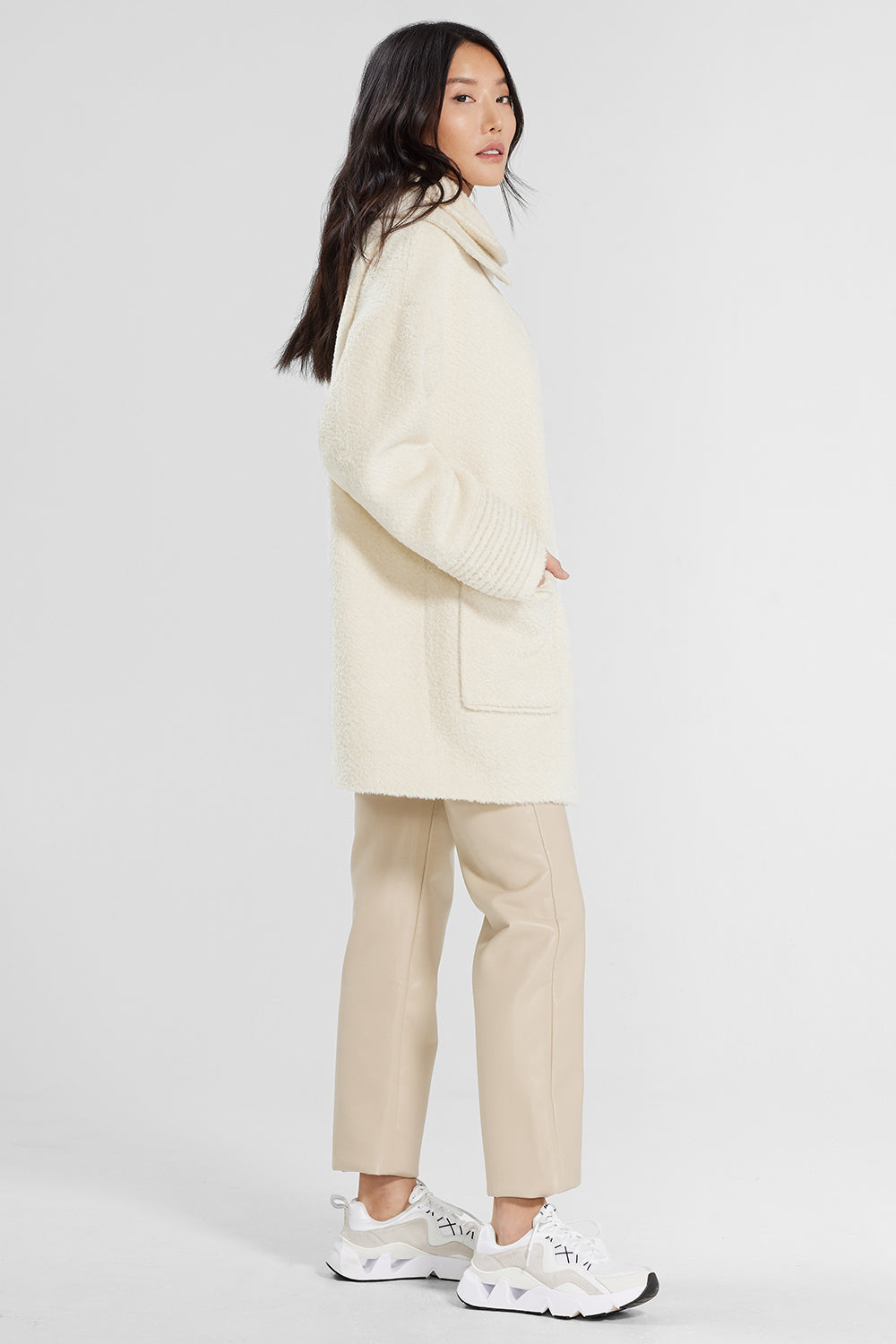 Sentaler Bouclé Alpaca Mid Length Oversized Coat with Signature Double Collar featured in Bouclé Alpaca and available in Ivory. Seen from side.