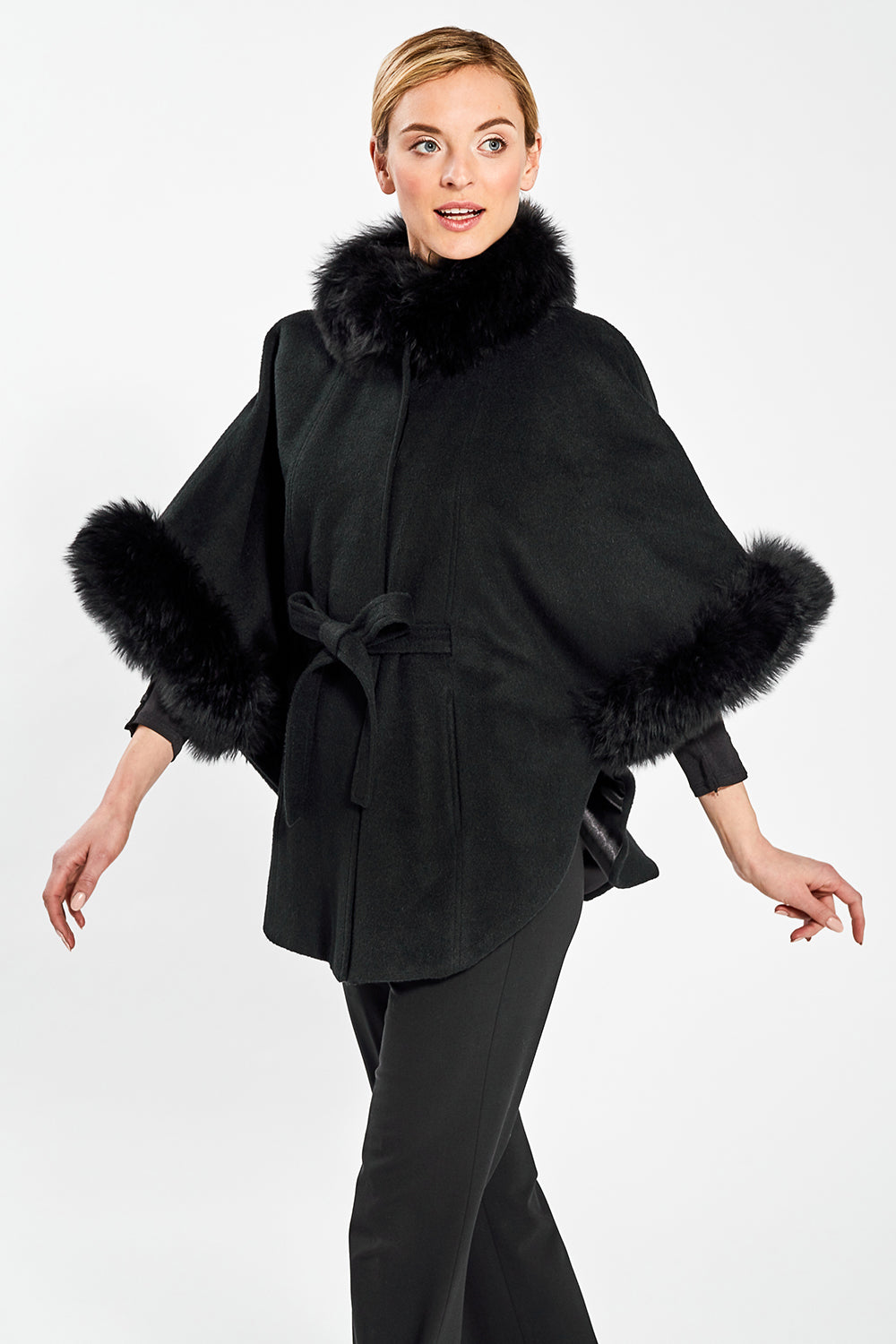 Sentaler Cape with Fur Collar and Cuffs featured in Baby Alpaca and available in Black. Seen from front.