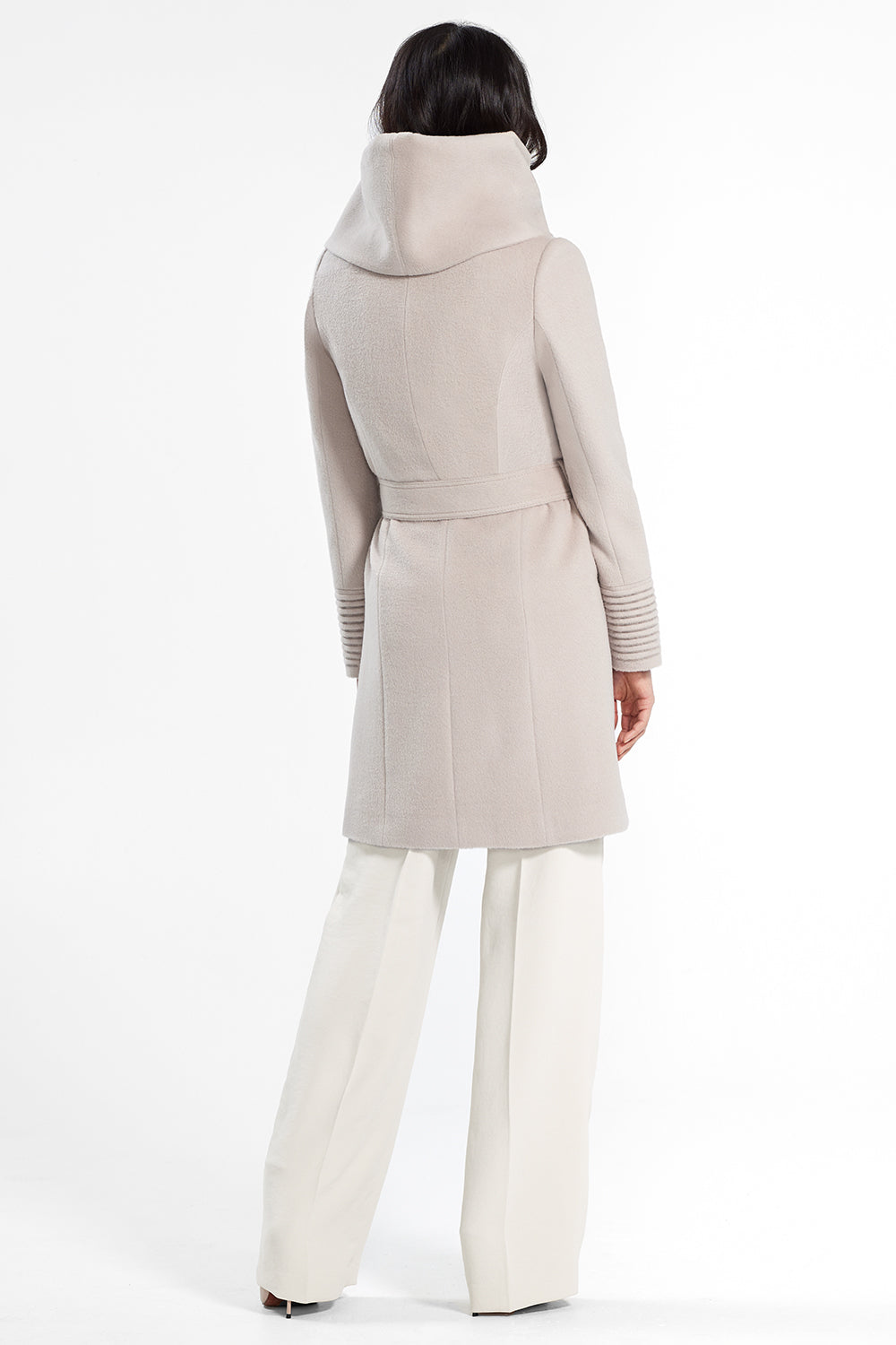 Sentaler Mid Length Hooded Wrap Coat featured in Baby Alpaca and available in Bleeker Beige. Seen from back.