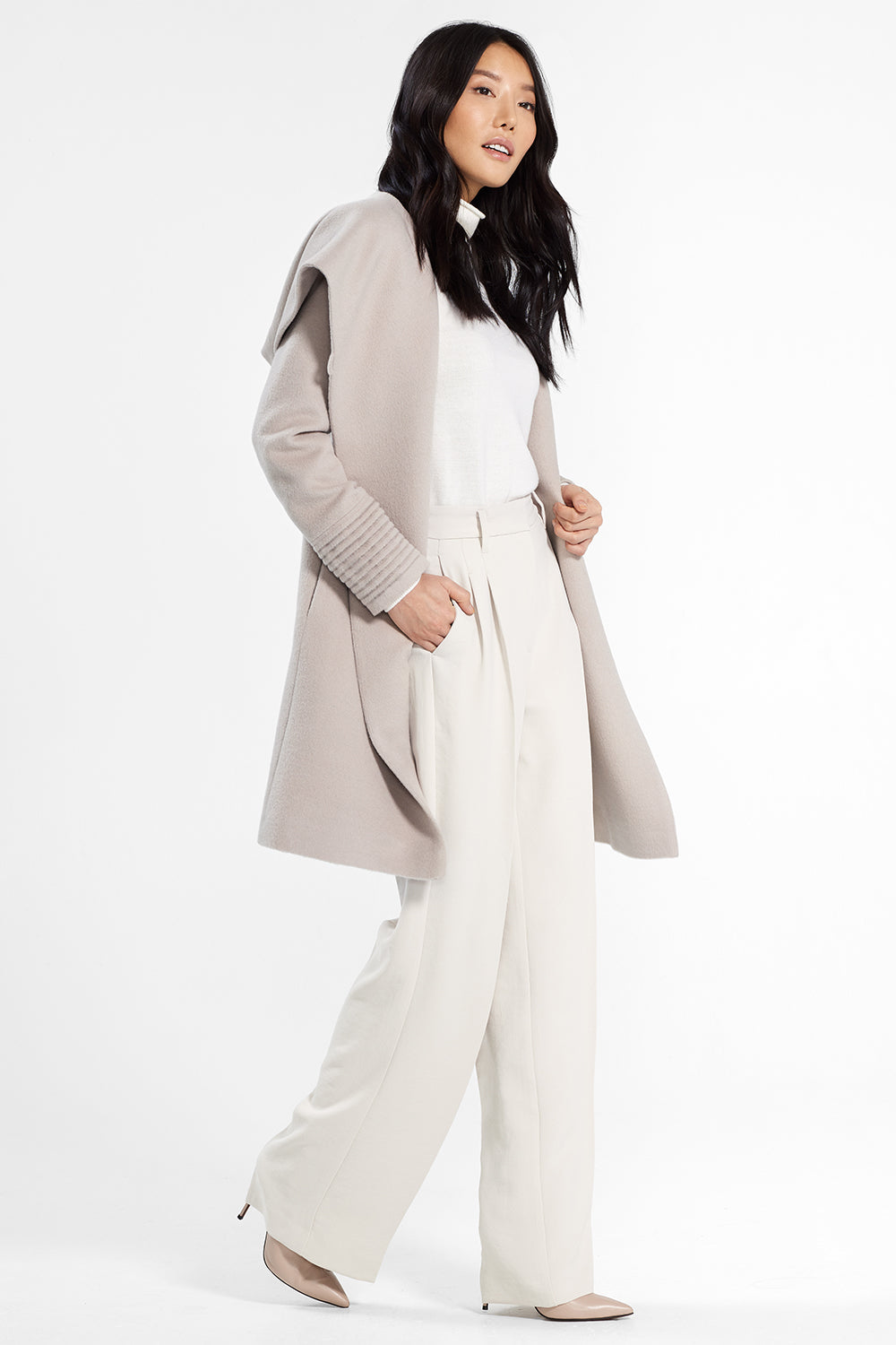 Sentaler Mid Length Hooded Wrap Coat featured in Baby Alpaca and available in Bleeker Beige. Seen from side.