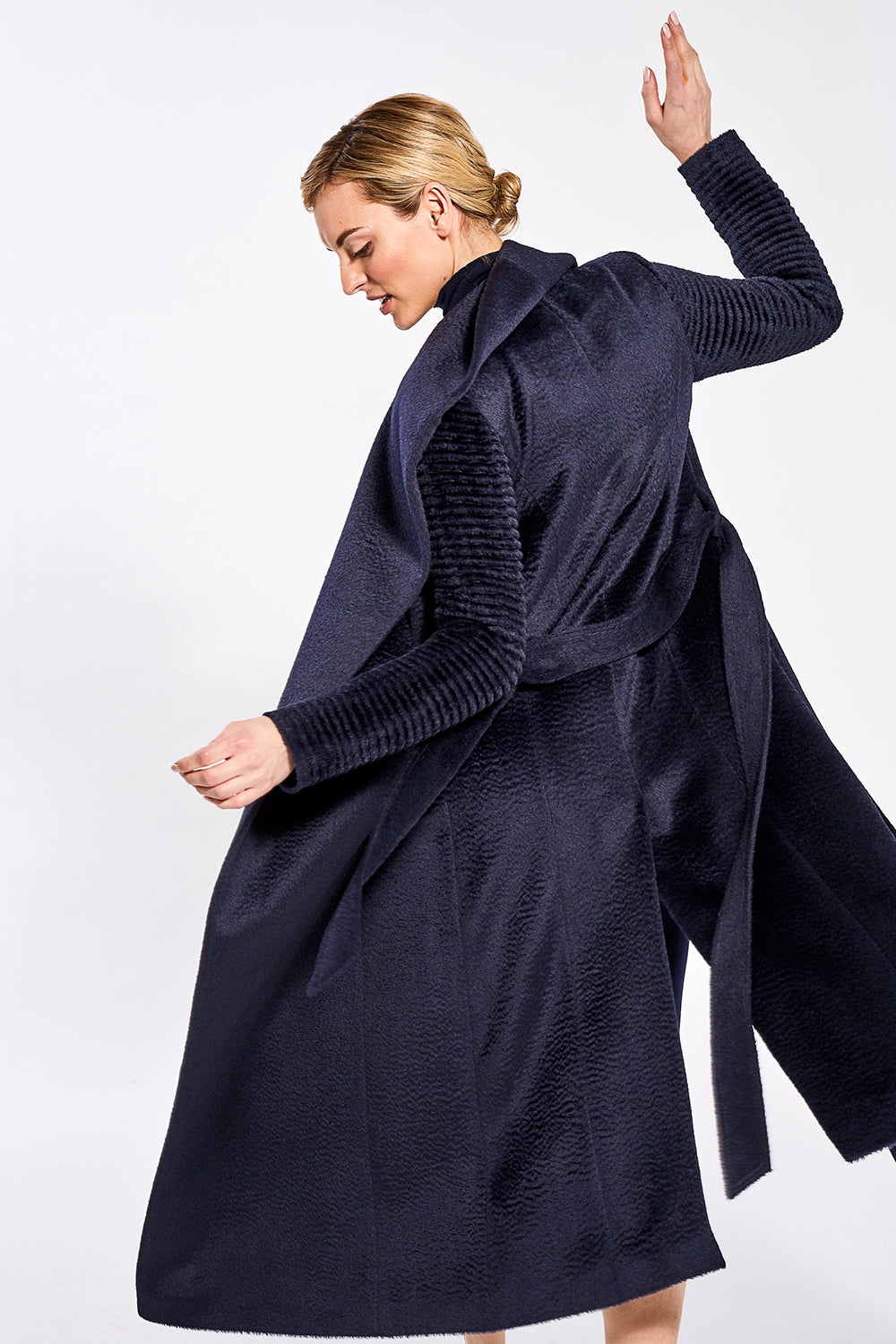 Sentaler Suri Alpaca Long Shawl Collar Wrap Coat with Ribbed Sleeves featured in Suri Alpaca and available in Navy. Seen in action.