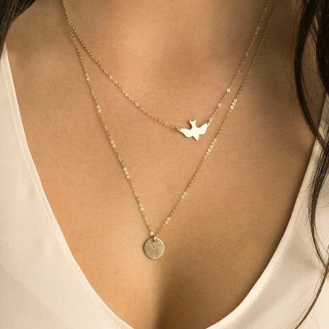Bird and Disc Strand Necklace