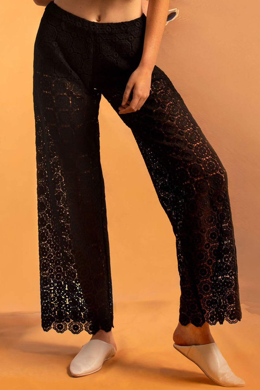 This is a detail photo of black lace pants with short lining and elastic waistband.