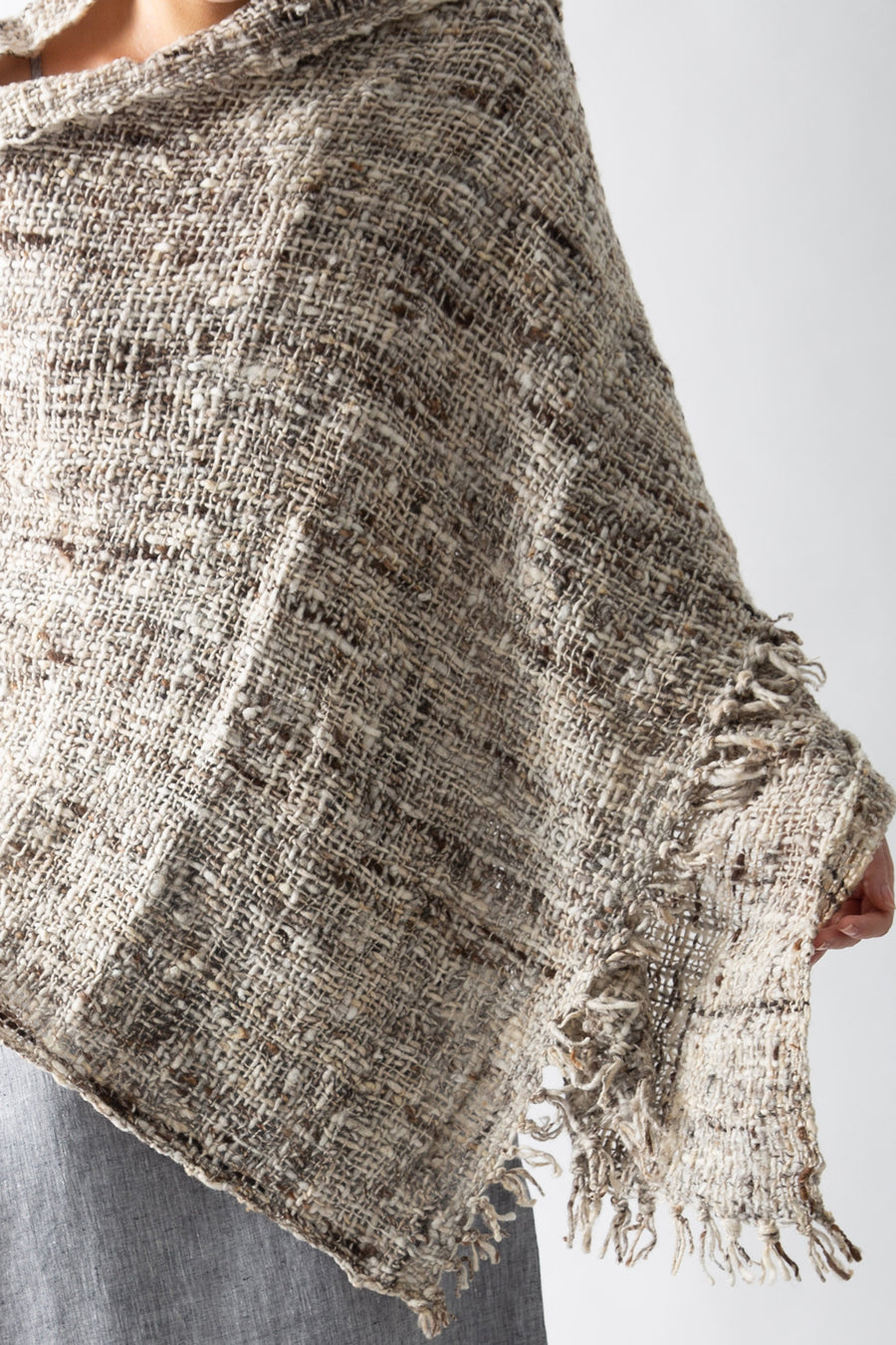 This photo is a close-up on the texture of the shawl, and also features the fringed tassels along the edge.