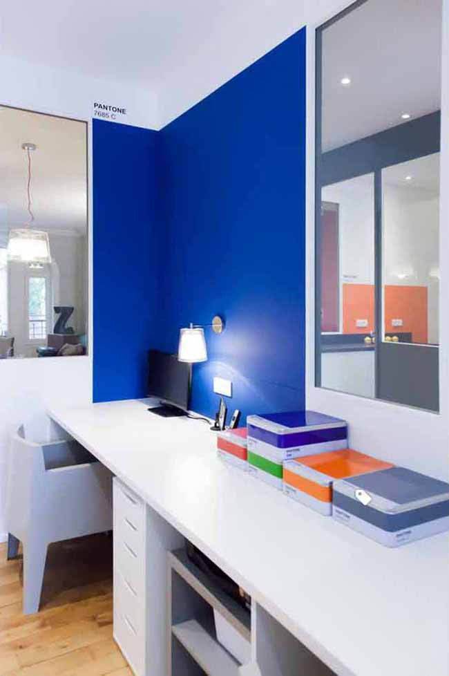 Home office with royal blue wall color