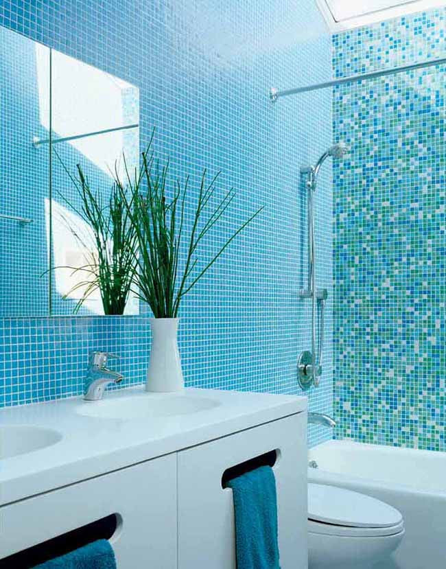 Bathroom with aqua blue interior walls