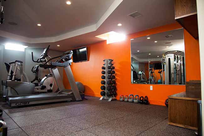 Home gym with orange walls