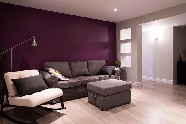 Basement living room wall with deep purple accent wall