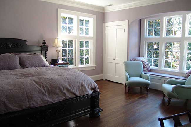 Bedroom with light purple and lilac walls
