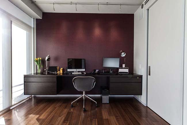 Home office with dark burgundy purple wall