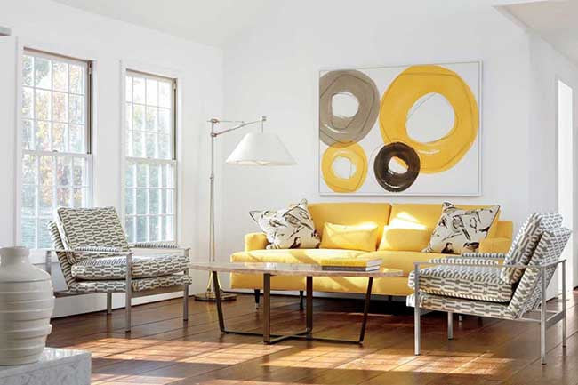 White living room with yellow couch