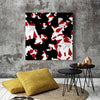 Red, Black & White Canvas Art in Room