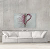 Love sample canvas art on a wall with sofa