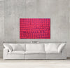 Pink Infusion sample canvas art on a wall with sofa