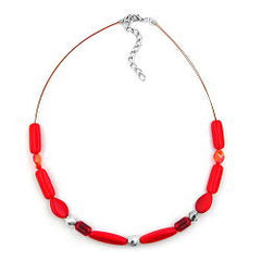 NECKLACE RED WATERED GLASS BEADS ON COATED FLEXIBLE WIRE 42CM