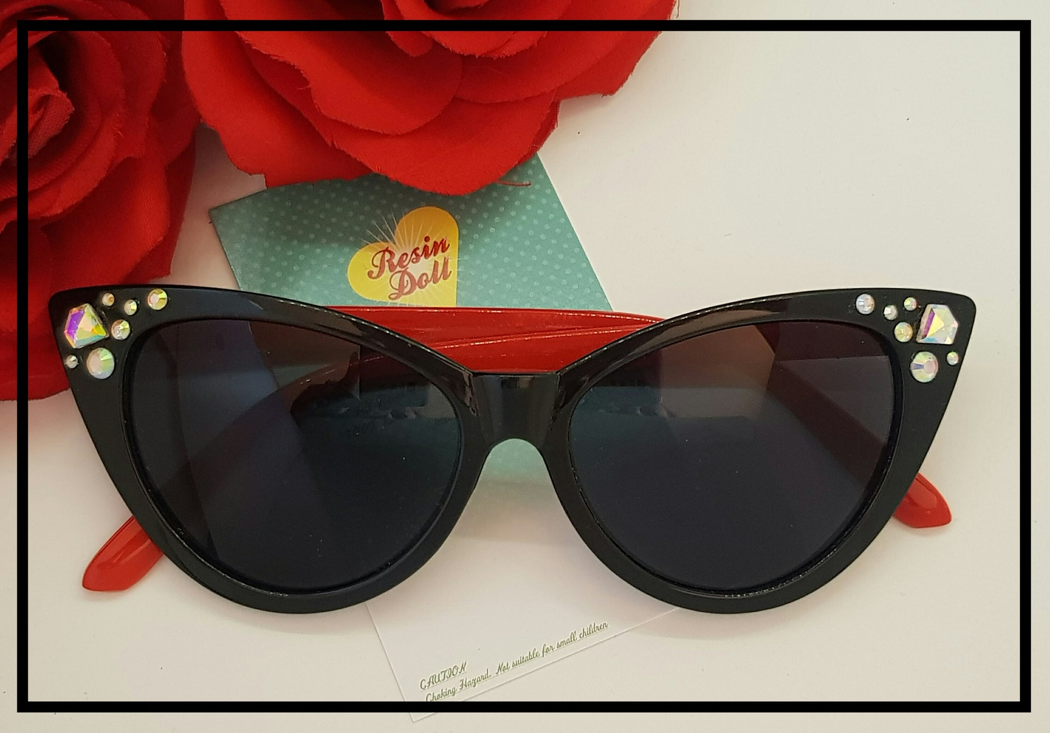 Black frame red arms sunglasses diamonds