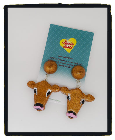 Brown cow drop earrings