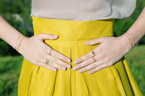 Jennie Kwon rings worn on on both hands with multiple styles per hand
