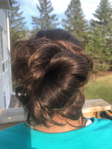 Black Hair Bun with Golden Brown Highlights