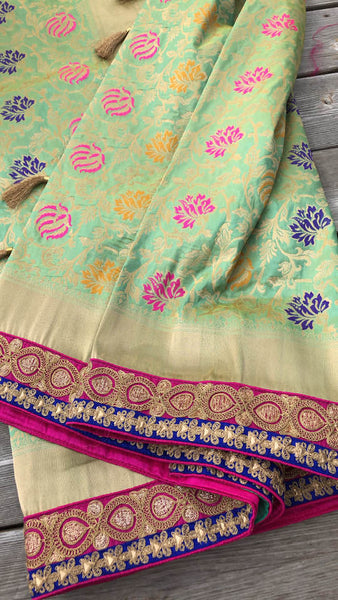 Pastel Green Pure Banarasi Brocade Silk Saree with Readymade Stitched Blouse.