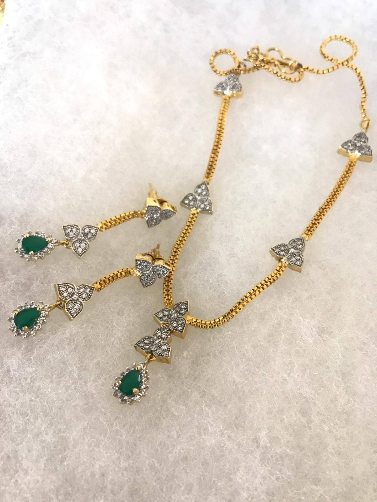Gold Matte Designer Chain Necklace Set with Matching Earrings with Green Stone