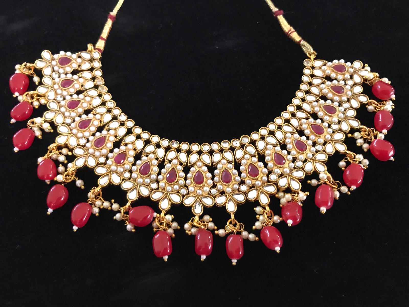 Gold Colored Kundan Choker Necklace Set with Red Beads & Matching Earrings