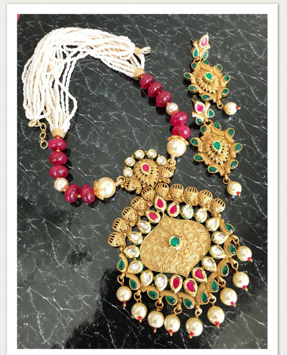 Gold Stone Kundan Necklace Set with Matching Earrings with Red & Green Stones