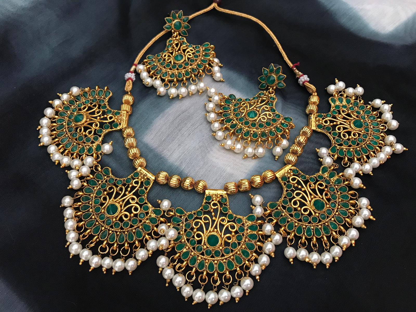 Green Stone Studded Pankhi Necklace Set With Metal Base & With Micron Gold Polish & Matching Earrings