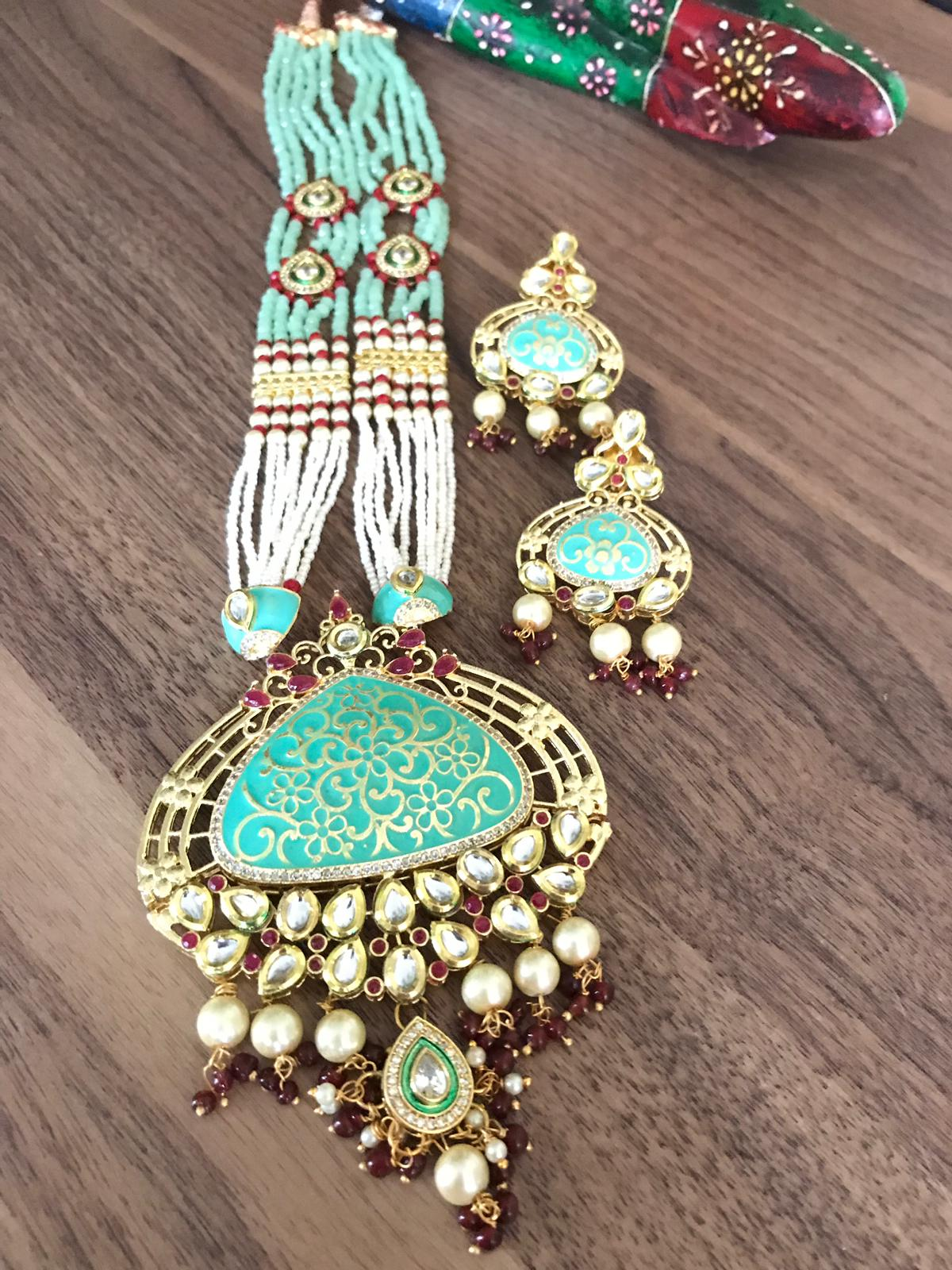 Sky Blue Garnet Kundan Necklace Set with Stonework with Matching Earrings