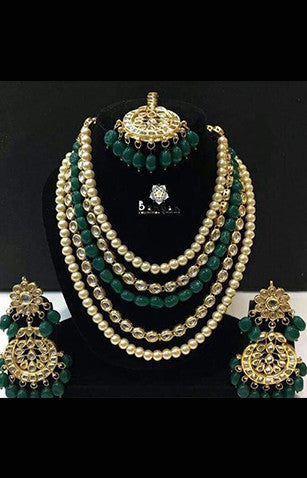Pearl, Polki, and Peacock Green Stone in a 5 layered Necklace with Earrings and Maang Ka Teeka