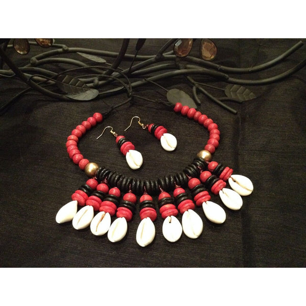Red,Black and White is always a lucrative combination and the piece is made with black and red beads with white conch shell beads arranged symmetrically. This necklace comes with matching earring.