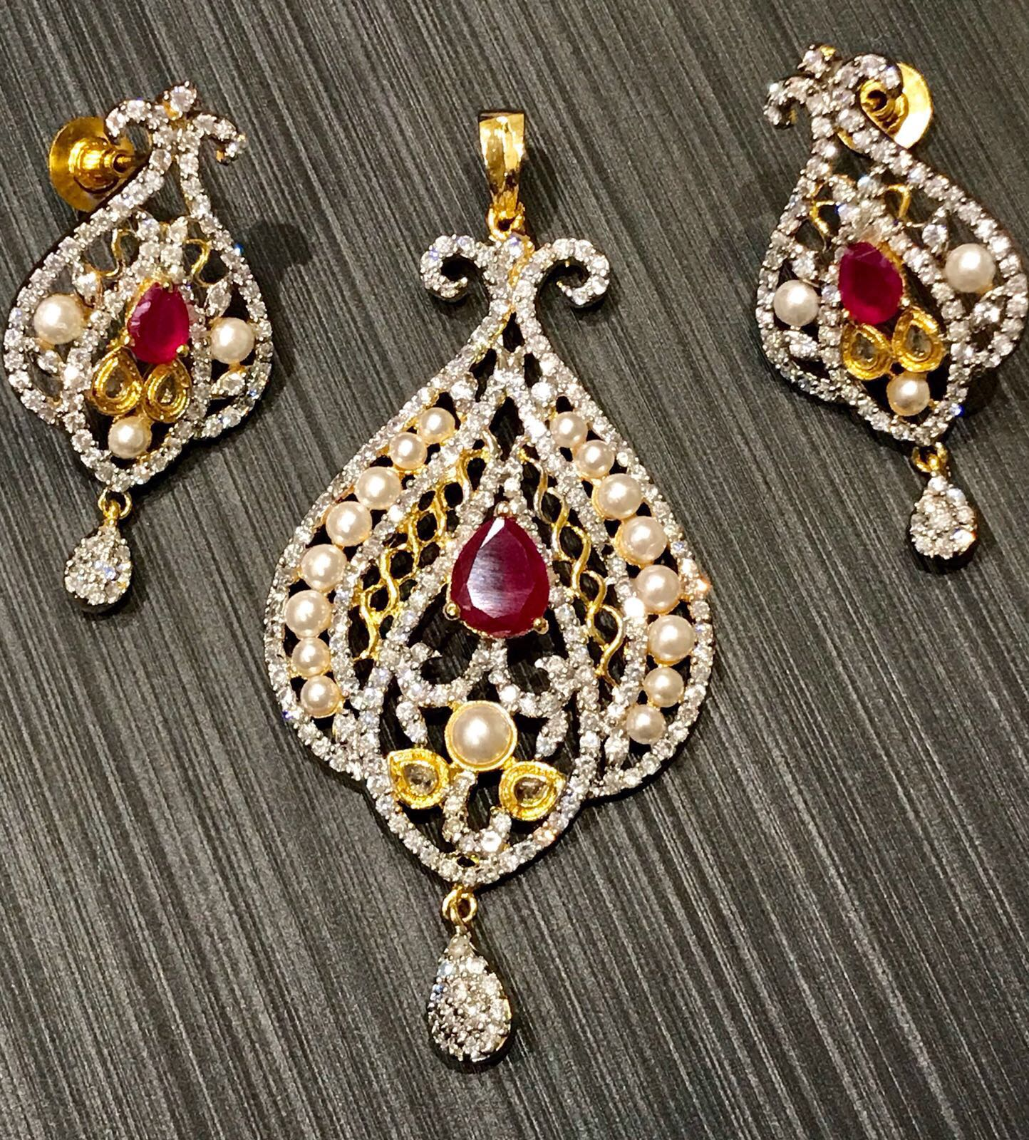 Ruby Red Meenakari CZ Stone Pearl Finish Gold Plated Pendant Set