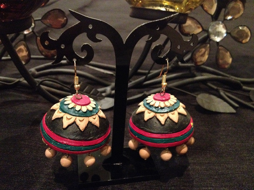This beautiful colorful clay Jhumkas or  chandelier brings in the traditional nostagia in comtemporary look. A must collectable trinkets. 1.5 inch hoop in a fisg hook