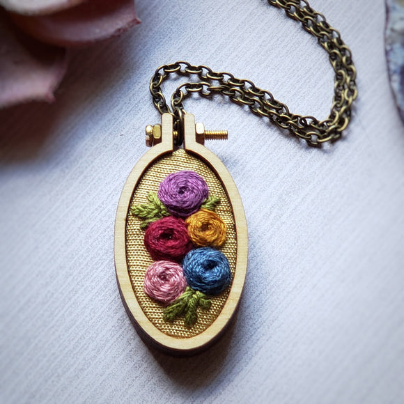 jewel tone embroidered pendant