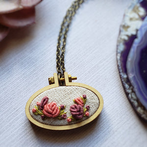 purple and pink embroidered necklace