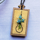 light blue embroidered flowers pendant